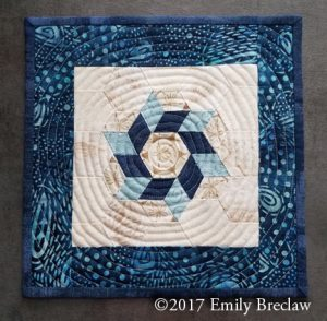 Sea Star mug rug pattern, blue and cream hexagons, free pattern by Emily Breclaw