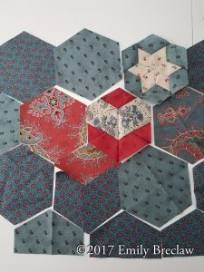blue and red hexagons showing an alternate colorway for the Loverly quilt pattern